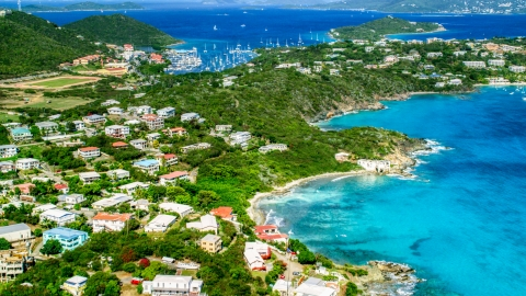 AX102_240.0000000F - Aerial stock photo of Island homes on the coast near a marina in Red Hook, St Thomas, the US Virgin Islands