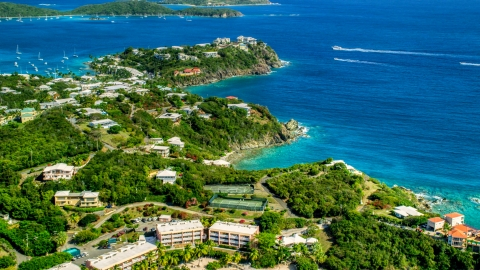 AX102_246.0000000F - Aerial stock photo of Upscale oceanfront homes beside sapphire blue waters, East End, St Thomas