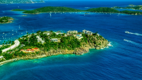 AX102_247.0000000F - Aerial stock photo of Hillside oceanfront homes overlooking sapphire blue waters, East End, St Thomas