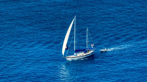 AX102_255.0000094F - Aerial stock photo of Sailboat in sapphire blue waters, St Thomas, USVI