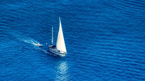 AX102_256.0000138F - Aerial stock photo of Sailboat in sapphire blue Caribbean waters, St Thomas, USVI