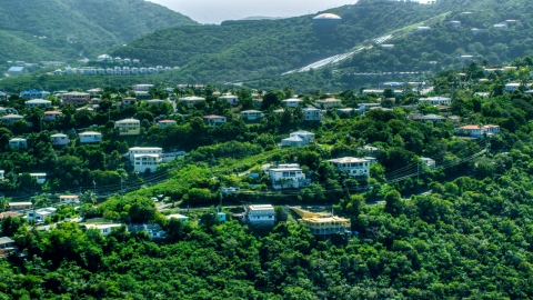 AX102_260.0000159F - Aerial stock photo of Hilltop homes and trees, East End, St Thomas, the US Virgin Islands