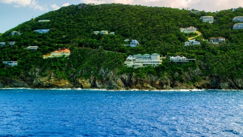 AX102_262.0000315F - Aerial stock photo of Hillside oceanfront mansions on a Caribbean island, Northside, St Thomas, the US Virgin Islands