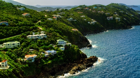 AX102_267.0000266F - Aerial stock photo of Hillside mansions on a Caribbean island coast in Northside, St Thomas, the US Virgin Islands