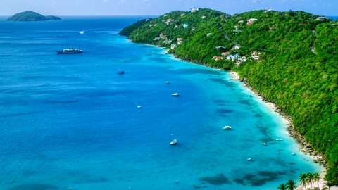 AX102_273.0000182F - Aerial stock photo of Sailboats in turquoise Caribbean waters and oceanfront island homes, Magens Bay, St Thomas