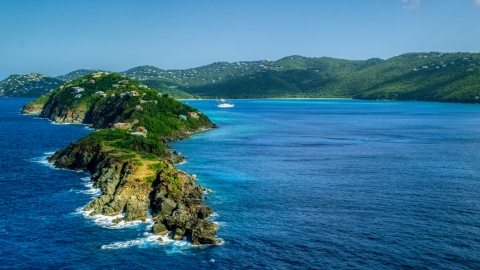 AX102_279.0000282F - Aerial stock photo of Picara Point and the crystal blue water in Magens Bay, St Thomas, USVI