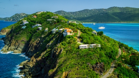 AX102_281.0000033F - Aerial stock photo of Hillside oceanfront homes by sapphire blue Caribbean waters, Magens Bay, St Thomas