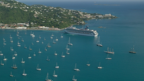 AX103_005.0000000F - Aerial stock photo of Cruise ship and sailboats in turquoise blue Caribbean waters, Charlotte Amalie, St Thomas