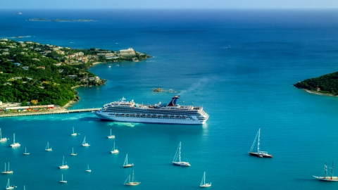 AX103_005.0000260F - Aerial stock photo of Cruise ship near sailboats in turquoise blue Caribbean waters, Charlotte Amalie, St Thomas