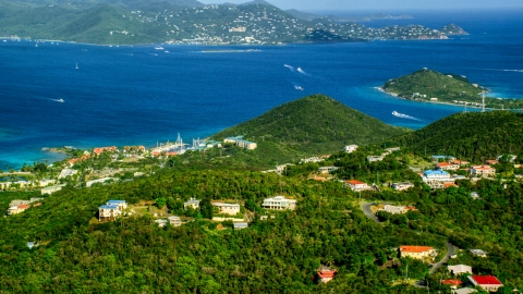 AX103_013.0000034F - Aerial stock photo of Caribbean resorts beside sapphire blue waters, East End, St Thomas