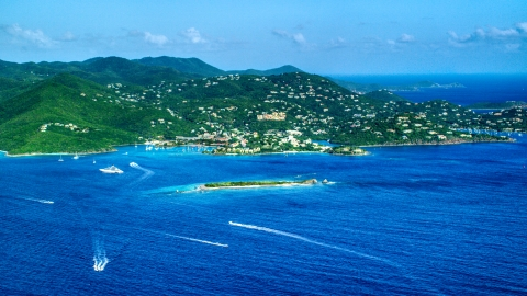 AX103_016.0000000F - Aerial stock photo of Coastal town on a hillside and blue Caribbean waters, Cruz Bay, St John