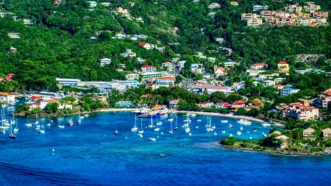 AX103_018.0000094F - Aerial stock photo of A coastal town and boats in the harbor with Caribbean blue waters, Cruz Bay, St John