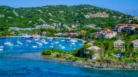 AX103_030.0000000F - Aerial stock photo of Turquoise blue Caribbean waters in the harbor with boats, Cruz Bay, St John