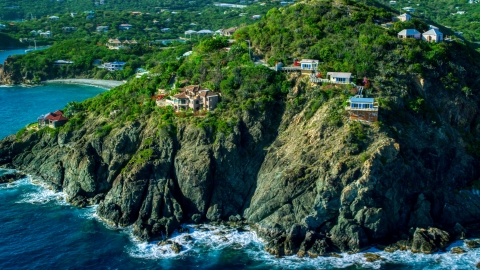 AX103_036.0000000F - Aerial stock photo of Cliff top mansions above sapphire blue Caribbean waters, Cruz Bay, St John