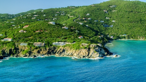 AX103_037.0000000F - Aerial stock photo of Hillside mansions overlooking Caribbean blue waters, Cruz Bay, St John