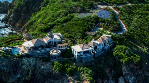 AX103_039.0000327F - Aerial stock photo of Hilltop mansion with a Caribbean blue ocean view, Cruz Bay, St John