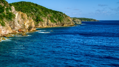 AX103_050.0000066F - Aerial stock photo of Coastal cliffs along sapphire blue Caribbean waters, Central, St John
