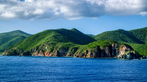 AX103_057.0000000F - Aerial stock photo of Coastal cliffs and jungle along sapphire blue Caribbean waters, Central, St John
