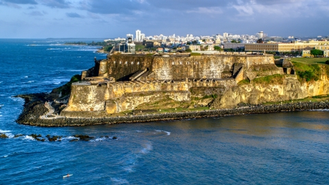 AX104_006.0000000F - Aerial stock photo of Historic Fort San Felipe del Morro, Old San Juan, sunset