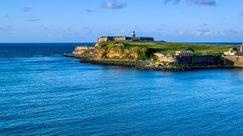 AX104_009.0000000F - Aerial stock photo of A view of Fort San Felipe del Morro, Old San Juan, Puerto Rico, sunset
