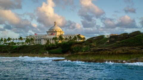 AX104_046.0000042F - Aerial stock photo of Oceanfront San Juan Capitol Building, Old San Juan Puerto Rico, sunset