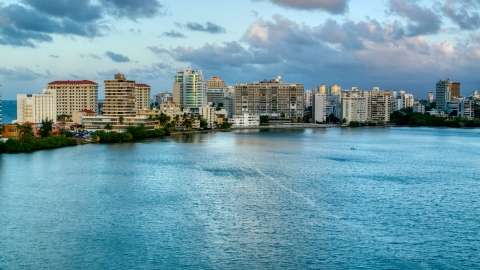AX104_060.0000309F - Aerial stock photo of Hotels beside Condado Lagoon, San Juan, Puerto Rico sunset