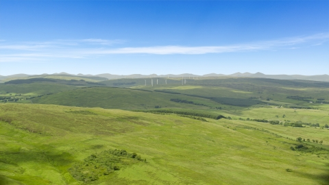 AX109_005.0000000F - Aerial stock photo of Hilltop windmills and farm fields in Denny, Scotland