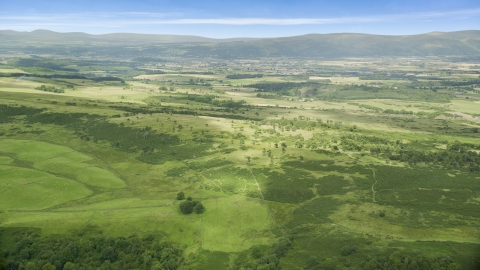 AX109_006.0000000F - Aerial stock photo of Green farmland and rural landscape, Stirling, Scotland