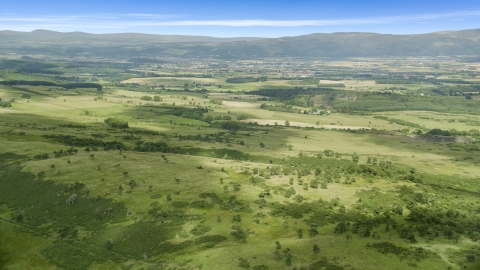 AX109_007.0000000F - Aerial stock photo of Farms in a green rural landscape, Stirling, Scotland