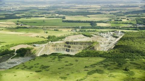 AX109_008.0000000F - Aerial stock photo of A quarry surrounded by farmland, Denny, Scotland