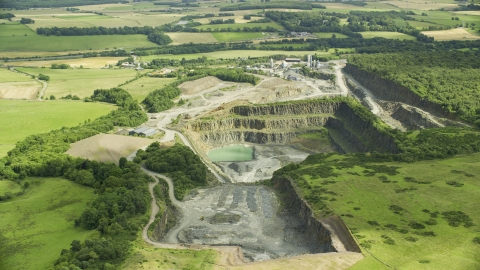 AX109_009.0000000F - Aerial stock photo of A quarry surrounded by farm fields, Denny, Scotland