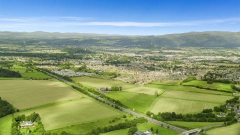 AX109_013.0000000F - Aerial stock photo of Farm fields near rural homes, Stirling, Scotland