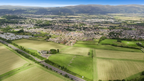 AX109_013.0000176F - Aerial stock photo of Farms and fields near rural homes, Stirling, Scotland