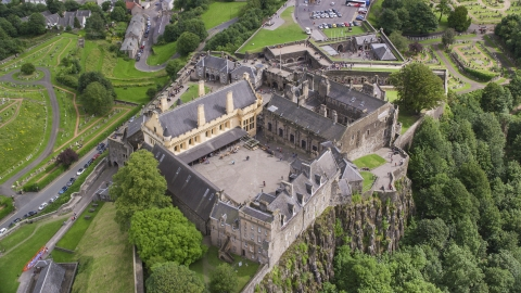 AX109_025.0000198F - Aerial stock photo of A view of the grounds of iconic Stirling Castle, Scotland
