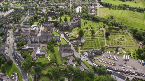 AX109_026.0000189F - Aerial stock photo of Church and cemetery by residential area, Stirling, Scotland