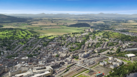 AX109_029.0000000F - Aerial stock photo of A view of historic Stirling Castle and residential area, Scotland