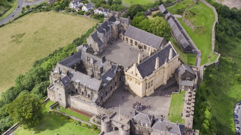 AX109_041.0000000F - Aerial stock photo of Iconic Stirling Castle and its grounds, Scotland