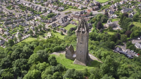 AX109_051.0000000F - Aerial stock photo of The historic Wallace Monument with tourists on top of the tower, Stirling, Scotland