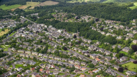 AX109_056.0000000F - Aerial stock photo of A residential neighborhood with trees in Stirling, Scotland