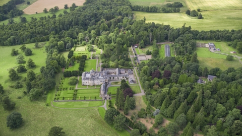 AX109_060.0000000F - Aerial stock photo of Keir House surrounded by trees, Scotland
