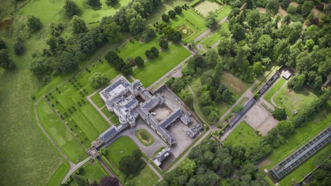 AX109_060.0000221F - Aerial stock photo of A bird's eye view of Keir House and estate grounds in Stirling, Scotland