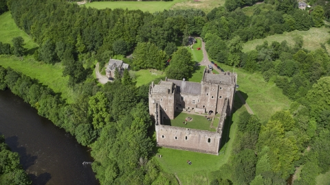 AX109_072.0000000F - Aerial stock photo of A view of historic Doune Castle and its grounds, Scotland