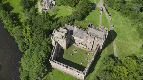 AX109_072.0000120F - Aerial stock photo of A bird's eye view of historic Doune Castle and its grounds, Scotland