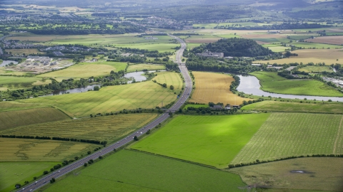 AX109_095.0000000F - Aerial stock photo of The M9 highway and farmland, Stirling, Scotland