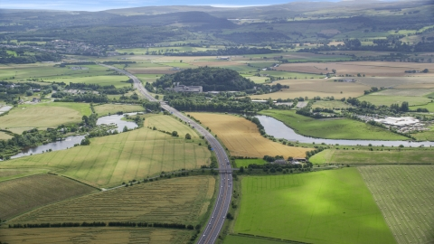 AX109_096.0000000F - Aerial stock photo of M9 highway and farmland in Stirling, Scotland