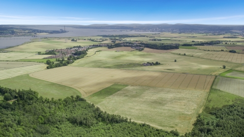 AX109_110.0000217F - Aerial stock photo of Farm fields around the village of Airth, Scotland