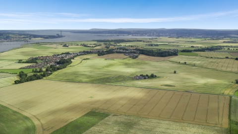 AX109_111.0000060F - Aerial stock photo of Farm fields around the village of Airth, Scotland