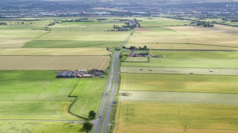 AX109_114.0000000F - Aerial stock photo of A roundabout on the A905 highway through farmland, Falkirk, Scotland