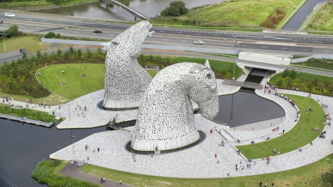 AX109_127.0000201F - Aerial stock photo of Profile view of The Kelpies sculptures in Falkirk, Scotland