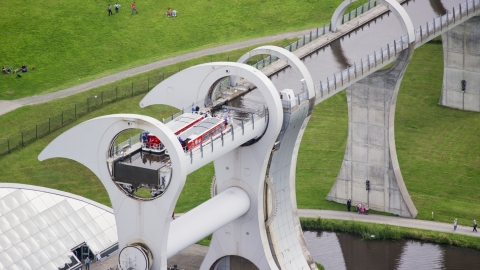 AX109_142.0000025F - Aerial stock photo of Ferries on the Falkirk Wheel boat lift in Scotland